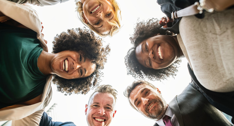 Diverse professionals in a circle